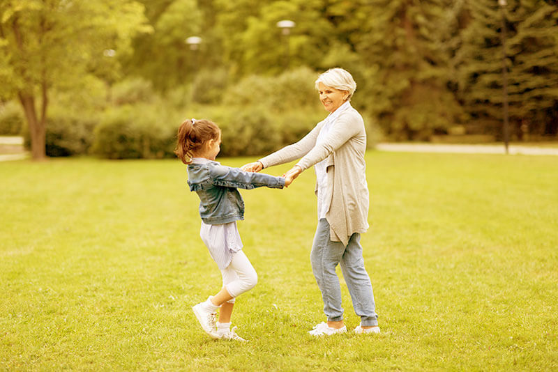 Older Woman Playing With Her Granddaughter - Yellowish Image