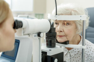older woman receiving eye exam