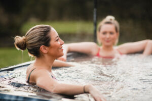 two women in hot tub