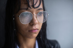 woman wearing glasses during rain storm